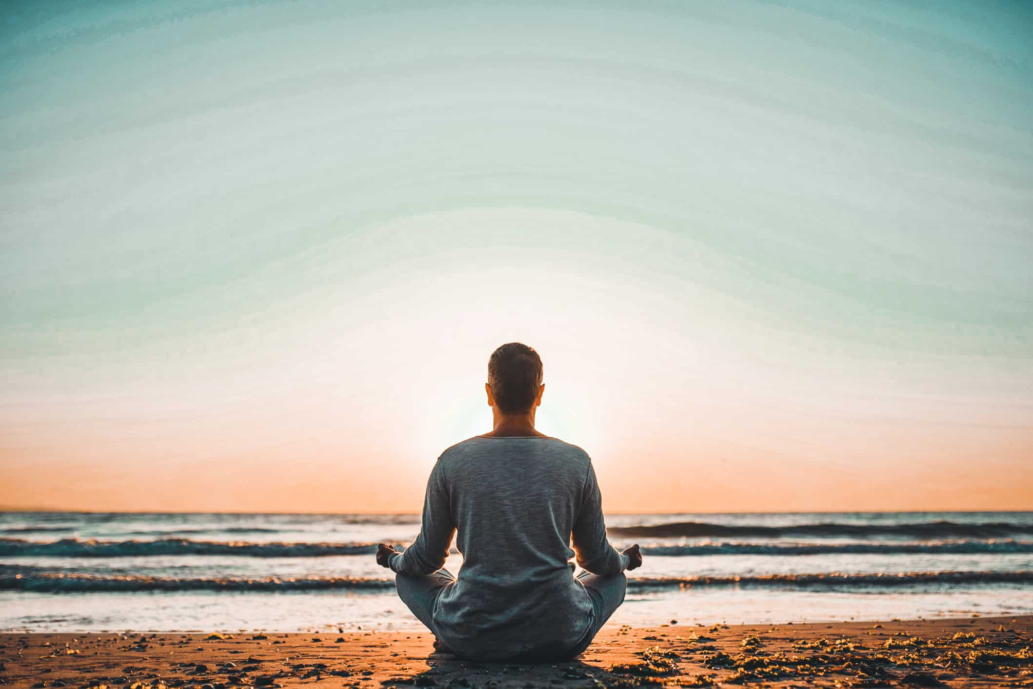 silhouette-of-young-man-relaxes-and-practices-yoga-in-the-morning-male-meditation-in-harmony-with_t20_xXzPyg 2