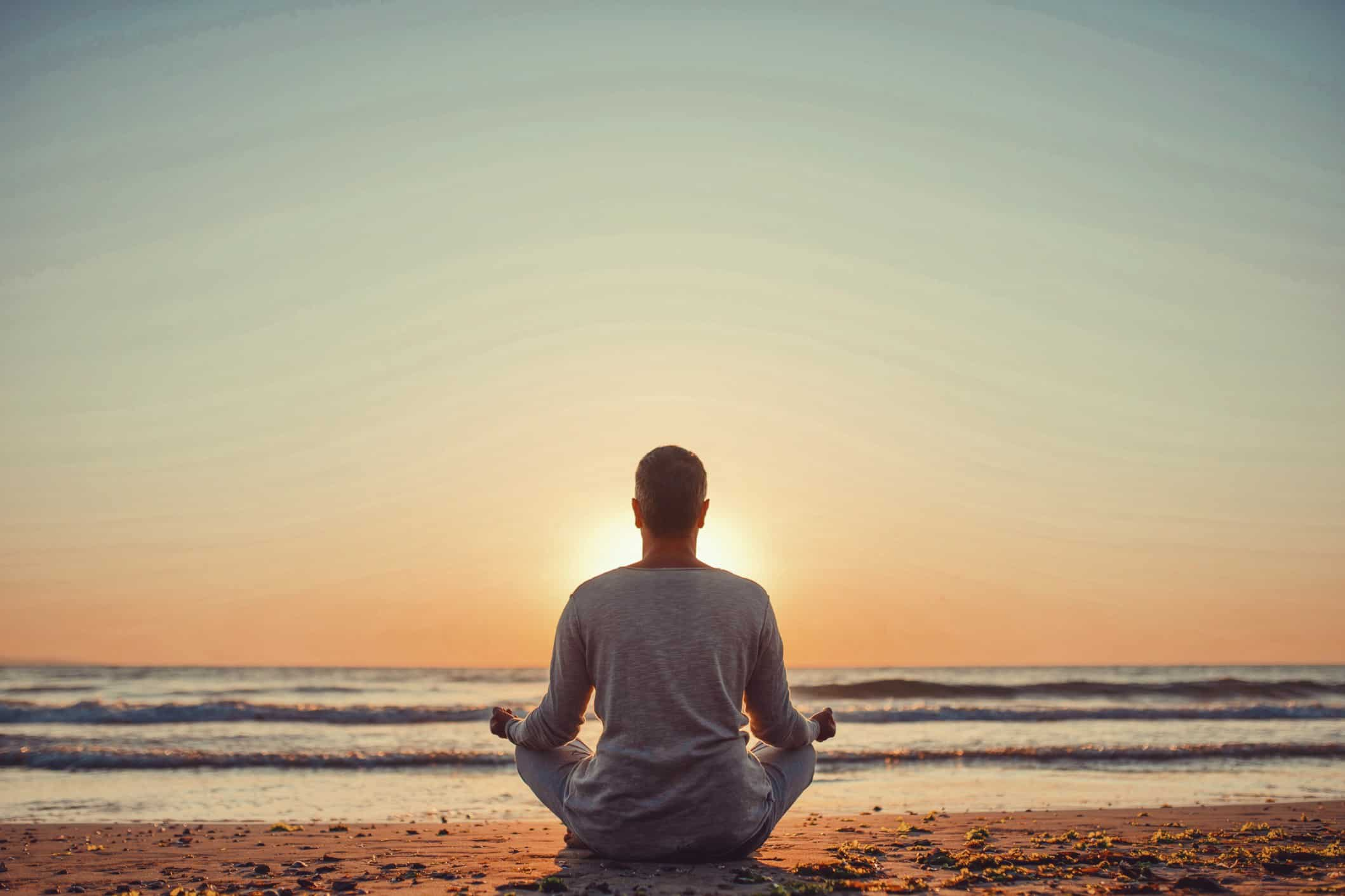 silhouette-of-young-man-relaxes-and-practices-yoga-in-the-morning-male-meditation-in-harmony-with_t20_xXzPyg