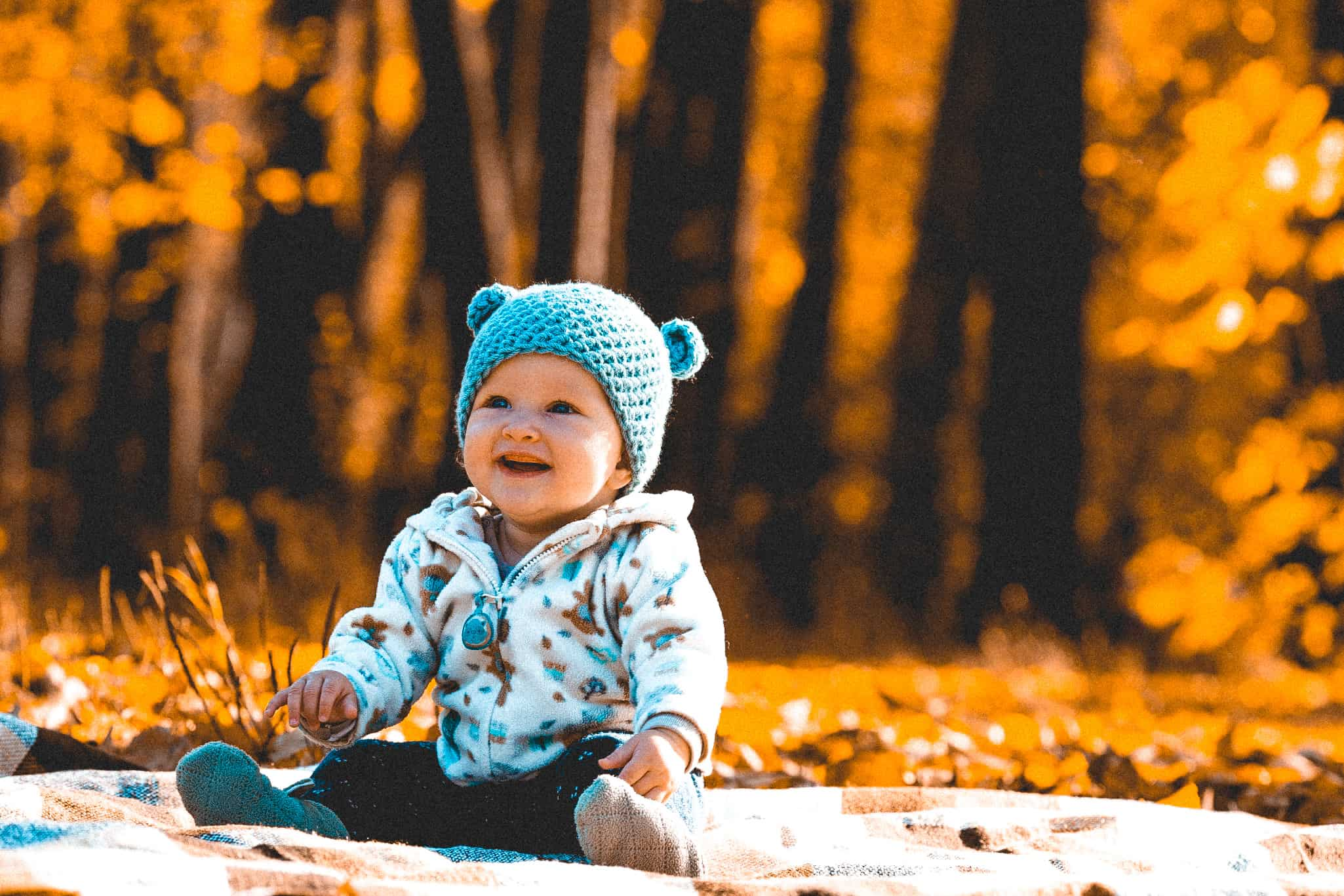 baby-is-learning-to-sit-little-girl-is-wearing-funny-hat-with-ears_t20_lxB1Gm